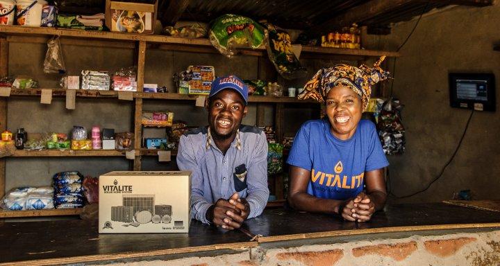 VITALITE Zambia Agent Mary Mpupuma (right) in her shop in Katoba Village.